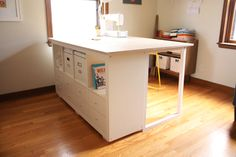 Custom DIY Sewing/Cutting Table – Noodlehead sewing table: expedit + + plywood (rough instructions in link) from noodlehead Creating useful and comfortable room design is key for family friendly. Diy Sewing Table, Sewing Desk, Sewing Spaces, Ikea Sewing Rooms, Sewing Closet, Sewing Cabinet, Hack Ikea, Craft Room Tables, Craft Rooms