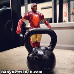 Awesome photo of Iron Man with some serious Iron... This is a 1lb Baby Kettlebell from http://www.Babykettlebell.com