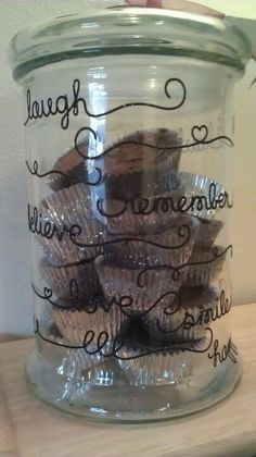 Cookie jar I made as a housewarming gift! Glass jar and a package of cute sticker sayings. I filled it with brownies and wrapped a ribbon with a card around the top. I thought it turned out cute! (supplies bought at hobby lobby, 50% off!)