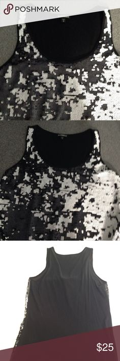 Express Sequin Black White Top Beautiful Express black and white tank top with sequins. Back is solid black. Second lining material on back of tank. Excellent condition! Front 100% polyester Inner front 100% polyester Back Body 60% cotton 40% Modal Express Tops Tank Tops