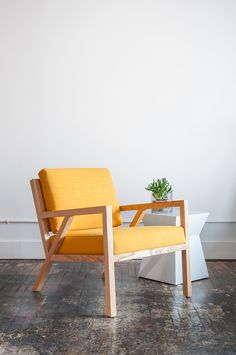 Gus* Modern | Truss chair in Laurentian Citrine is inspired by the work of the Sarasota School of Architecture. In both modern and traditional spaces, this mid-century styled chair features a solid natural oak frame with an interlocking truss base and finger joint detailing on the arms.