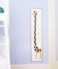 Giraffe height chart in child's bedroom. create a growth chart for Statler's room. what animal?