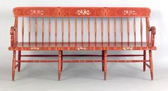 """Pennsylvania painted arrowback settee, 19th c., retaining its original floral decoration on a red ground with yellow pinstriping, 35"""" h. (back), 16 1/2"""" h. (seat), 72"""" l."""