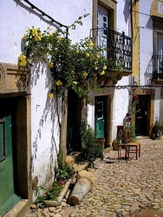 Castelo de Vide village - Just above is the mazelike Judiaria, where small white houses sprout vivid pots of geraniums. Its cobbled alleys conceal a 13th century synagogue and are lined with fine gothic doorways.#Marvao #Alentejo #Portugal
