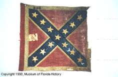 Battle flag of the 11TH REGIMENT Florida Volunteer Infantry.  St. Andrew's cross design; red leading edge; square format.  No unit designation. (Identified by capture records).  No battle honors.  Captured at Sailor's Creek on April 6, 1865 by Lieutenant Aaron S. Lanfare of the 1st Connecticut Cavalry, attached to the 3rd Cavalry Division, General George Custer commanding.