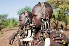 The Mursi Tribe are an ancient tribe that live in Ethiopia. Visit them on a holiday to Ethiopia and learn about their tradition and culture. Beauty Around The World, Around The Worlds, Mursi Tribe, Getting To Know, Ethiopia, Horn, Africa, Lips, Culture