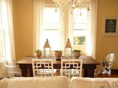 eclectic dining room: rustic wood dining table, West Elm overlapping squares chairs, and clear acrylic arm chairs