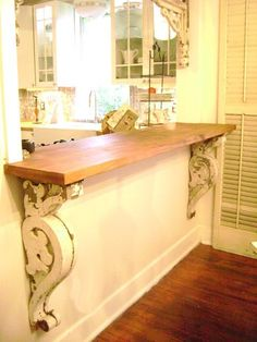 A trip to a salvage store for corbels and to Lowe's for wooden shelf.a nice looking, heavy piece to fill a large space at a fraction of the cost. Corbels make any shelf or counter look great. Cocina Shabby Chic, Shabby Chic Kitchen, Diy Kitchen, Kitchen Pass, Kitchen Ideas, Pass Through Kitchen, Kitchen Dining, Open Kitchen, Rustic Kitchen
