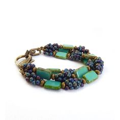 Hey, I found this really awesome Etsy listing at https://www.etsy.com/listing/83513743/turquoise-beaded-bracelet-picasso-glass