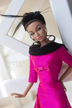 Now that I have gotten over the shock of how realistic some of the knew Barbies look I just pin for the outfits.
