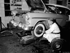 Harold Marshall uses the special wheel balancer to check a car at Ames Tune-Up and Service. 1955