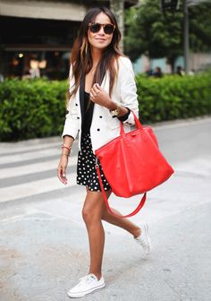 black and white with a bright red handbag