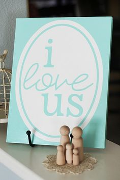 """i love us"" ready to print on canvas - in 4 different colors. and a link to an offer for a free 8x10 canvas print! gonna order a red one for valentines! cute clothespin family at the bottom, too!"