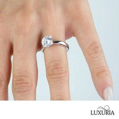 A High quality fake solitaire diamond engagement ring from the Luxuria brand. The ring has a hearts & arrows (H & A) pattern cubic zirconia central stone. Diamond Solitaire Rings, Diamond Engagement Rings, Cubic Zirconia Engagement Rings, Silver Wedding Bands, Diamond Simulant, Heart With Arrow, Diamond Settings, Jewelry Branding, Proposal