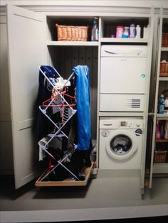 a clothes horse you can wheel out from a cupboard. Would need 3 or 4 clothes horses in a row. Get plugs in cupboard and make heated. Need groves in doors to level humidity out. Drying Cupboard, Laundry Cupboard, Utility Cupboard, Laundry Closet, Laundry Room Storage, Cupboard Storage, Laundry Rooms, Small Utility Room, Downstairs Toilet