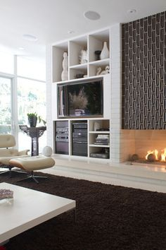 Amazing fireplace with storage and tv built in! Beautiful! Love the rest of the room too.