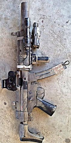 A sub machine gun with a suppressor and flashlight. Great for home defense and house fighting . Weapons Guns, Military Weapons, Guns And Ammo, By Any Means Necessary, Submachine Gun, Fire Powers, Cool Guns, Awesome Guns, Big Guns