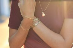 Navy T & gold jewellery