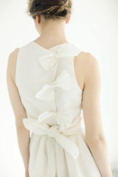 Bows down the back.  Katie Ermilio SS 2012.