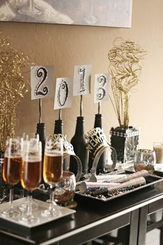 New Year's Eve Party Ideas | A to Zebra Celebrations - sparkly beer bottles as candle or place holders