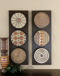 This decorative wall art is finished in a combination of mahogany red,  burnt orange,