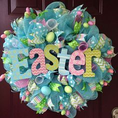 The pastel colored Easter sign is focal point of this whimsical 26 deco mesh wreath. It is embellished with a variety of coordinating ribbons. Brightly colored Easter egg sprays with sprigs of glittered grass are added for a fun spring touch. Wreath Crafts, Diy Wreath, Wreath Ideas, Wreath Making, Tulle Wreath, Burlap Wreaths, Easter Projects, Easter Crafts, Easter Decor