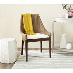 The Franco sloping chair combines classic transitional style with the natural beauty of finely woven rattan.