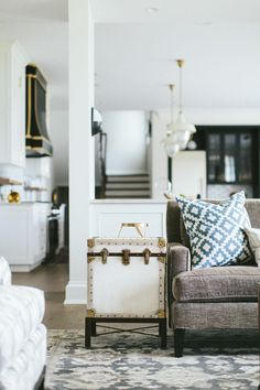 Replace a standard side table with a vintage trunk. | 25 Absoluely Gorgeous Living Room Decor Ideas | StyleCaster