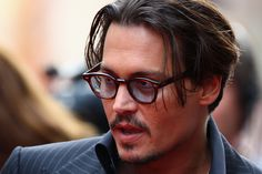 Johnny Depp Actor Johnny Depp arrives at the European Film Premiere of 'Public Enemies' at The Empire Leicester Square on June 29, 2009 in L...