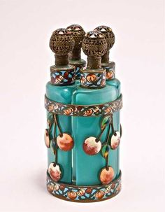 Enameled Perfume Tantalus French perfume tantalus, four bottles (one lip flake), cased blue-green crystal, filigree metal stopper heads, champleve enameled metalwork Perfume Atomizer, Antique Perfume Bottles, Vintage Bottles, Beautiful Perfume, Bottles And Jars, Chinoiserie, At Least, Blue Green, Art Deco