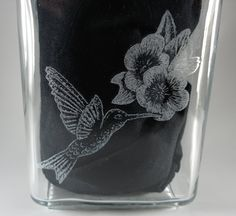 Humming bird engraved on the back of a jar.