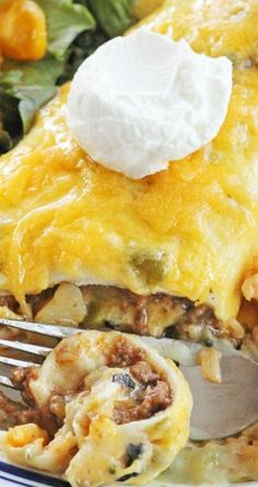 MIAM Green Chile Smothered Burrito Recipe ~ These burritos are filled with a delicious ground beef and potato mixture then smothered with green chile sauce and topped with tangy cheddar cheese. Smothered Burritos, Tacos And Burritos, Mexican Burritos, Mexican Dishes, Mexican Food Recipes, Mexican Desserts, Filipino Desserts, Drink Recipes, Dinner Recipes