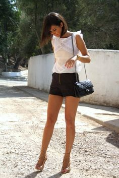 white blouse, black shorts, paired with nude sandals