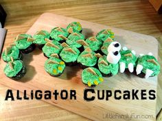 """DIY Alligator Cupcakes:  Green frosting  Graham cracker triangles  Yellow jelly beans for """"claws""""  2 Big Marshmallows for eyes with 2 black jelly beans  Cut marshmallows for teeth  Green sprinkles all over the top"""