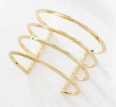 Brazalete rídido de 4 bandas ajustable, elaborado en 4 baños de oro de 18 kt. Modelo 415456.