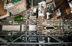 hotographer Navid Baraty shuns safety and simply leans over some of New York City's tallest skyscrapers to achieve these amazing snaps
