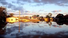 The sun rises over flooded streets as parts of southern Queensland experiences record flooding in the wake of Tropical Cyclone Oswald on Jan. 30, 2013, in Bundaberg, Australia. (Chris Hyde/Getty Images) Weather.com's Top 100 Photos of 2013 - weather.com