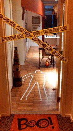 "Trick or Treat! My front door this year >:o)> Hallween idea for apartment or condo door; ""chalk"" outline, CAUTION tape"