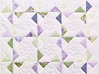 pinwheel quilt.  made by AMISH COUNTRY QUILTS