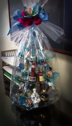 "High tea?......OH please! Who wants tea and crumpets....This is my kind of tower! .....auction basket of ""mini's"" my drinking club donated. So cute!"