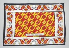 "Kanga, Designed in: Mombasa (town)MALI YA ABDULLA, Biashara Street, Mombasa in 2003:  - A rectangular machine-printed white cotton cloth, kanga, with a continuous patterned border of yellow, black and red floral motifs, enclosing a central red rectangle with repeating diagonal designs in red, yellow and white. Just above the centre of the lower border is an inscription in Kiswahili written in the Roman script: SINA SIRI NINA JIBU - "" I have no secrets but I have an answer""."