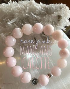Get your hands on our 12mm pink Mangano Calcite bracelet. A rare gem from Peru. This healing stone has a sweet loving vibration. It is a powerful amplifier and cleanser of energy. It speeds up development and growth. It has the ability to change ideas into action. Alleviates emotional stress and replaces it with serenity and has  a positive effect, especially where someone has lost hope or motivation. Is it calling you? Calcite jewelry | zen jewelz | ZenJen | crystal Healing jewelry