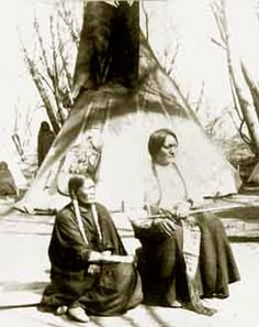 Sitting Bull and His Favorite Wife  Sitting Bull posed here with his eighth wife, said to be his favorite. Together they had six children. Sitting Bull's wife was 30 years old at the time of this photograph, which was number five in a series of 24.  Photographed in 1882 by Bailey, Dix & Mead
