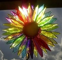 Flower Suncatcher this is fused glass.  I wonder if you could make this out of recycled plastic bottles?