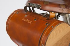 - Summary - More Info - Shipping A stylish leather saddle bag inspired by the brandy barrels carried by St. Bernard mountain dogs, the Seat Barrel Bag is hand-crafted out of high-quality American vege