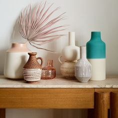 Our modern Allondra vase streamlines the classic urn shape with clean lines and gentle curves. The serene, two-color palette glazes the body in white and the neck blush pink. Lovely on its own, the ceramic vase also houses dried botanicals and faux flower sprays. The Allondra vase is a Crate and Barrel exclusive.     Glazed earthenware  Not watertight  Dust with soft cloth  Made in Portugal Palmetto Leaf, Painted Glass Vases, Flower Spray, Diy Flower, Flower Pots, Botanical Decor, Decorating Coffee Tables, Sunroom Decorating, Pink Paper