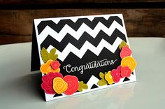 handmade card ... bright and beautiful ... bold black and white chevrons ... like the stamped and die cut flowers done with bright papers ... great card!!