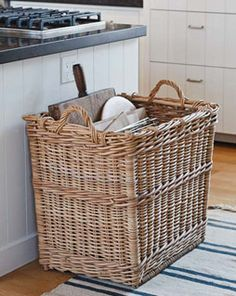 Basket for large cookie sheets and cutting boards via the Barefoot Contessa.