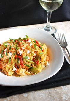 Zucchini Noodles In A Creamy Roasted Red Pepper Sauce - An easy dinner that is low carb, gluten free and ALL kinds of delicious! | Foodfaithfitness.com | @FoodFaithFit