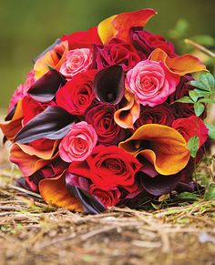 Bouquet of coral and red roses, black magic roses, and miniature mango and black magic calla lilies  $200, by Petit Fleur Event Flowers & Decor, Ferndale, MI